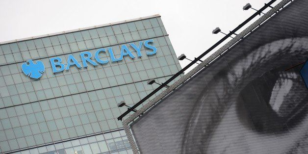 Barclays' bank logo is seen above a billboard displaying art photography in New York, June 11, 2013. AFP PHOTO/Emmanuel Dunan