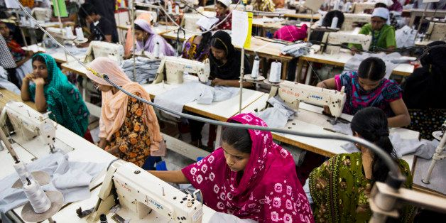Workers sew garments on the production line of the Protik Apparels garment factory in Dhaka, Bangladesh, on Monday, April 29,