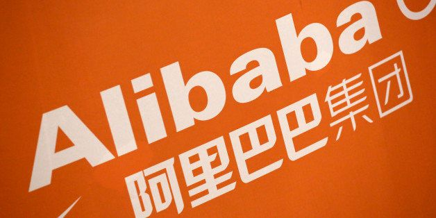 FILE - In this Sept. 19, 2014 file photo, the Alibaba logo is displayed during the company's IPO at the New York Stock Exchan