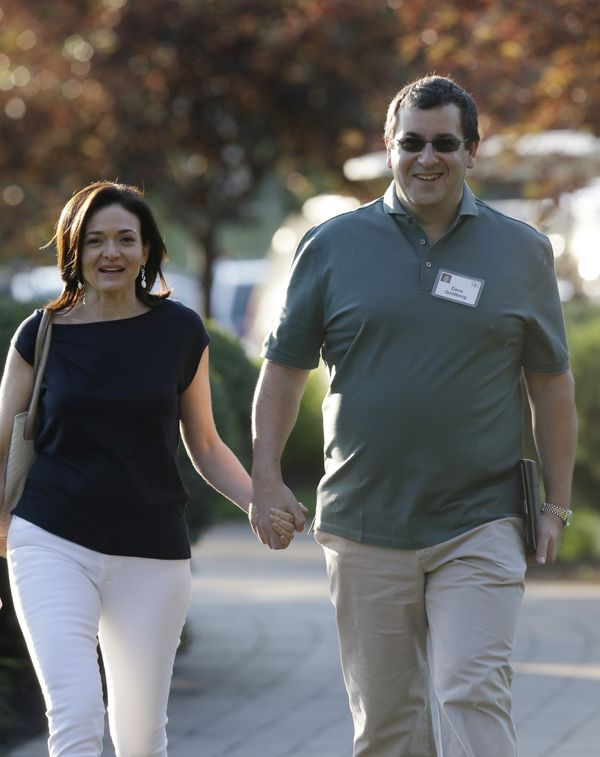 Sheryl Sandberg, COO of Facebook, and her husband David Goldberg walk to the morning session at the Allen & Company Sun V