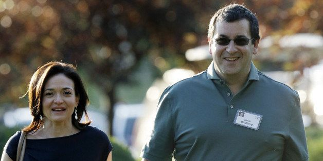 FILE - In this July 10, 2013 file photo, Sheryl Sandberg, COO of Facebook, left, and her husband David Goldberg, CEO of Surve