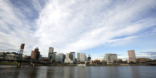The Portland skyline is visible on the bank of the Willamette River in Portland, Ore., Wednesday, Dec. 3, 2014.  The White Ho