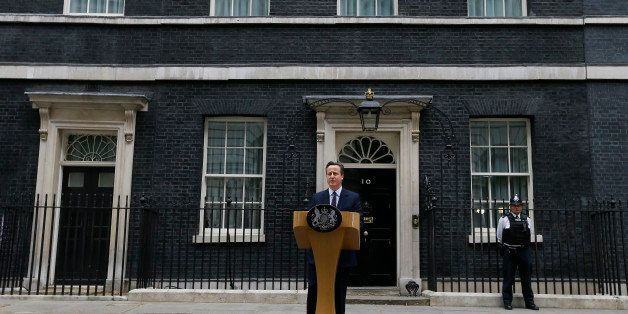 Britain's Prime Minister David Cameron speaks to the media outside 10 Downing Street in London Friday, May 8, 2015. Cameron's