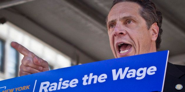 Gov. Andrew Cuomo speaks during a labor rally, announcing a plan to get a minimum  $15 an hour wage hike for fast-food worker