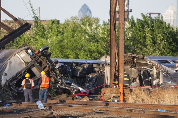 PHILADELPHIA, UNITED STATES - MAY 13: Rescue crews and investigators inspect the site of an Amtrak train derailment in Philad