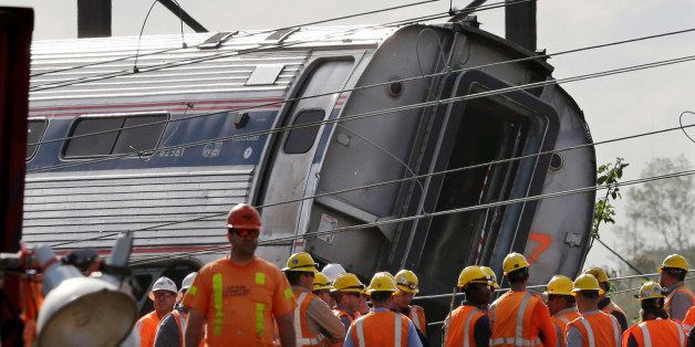 Emergency personnel gather near the scene of a deadly train derailment, Wednesday, May 13, 2015, in Philadelphia. The Amtrak