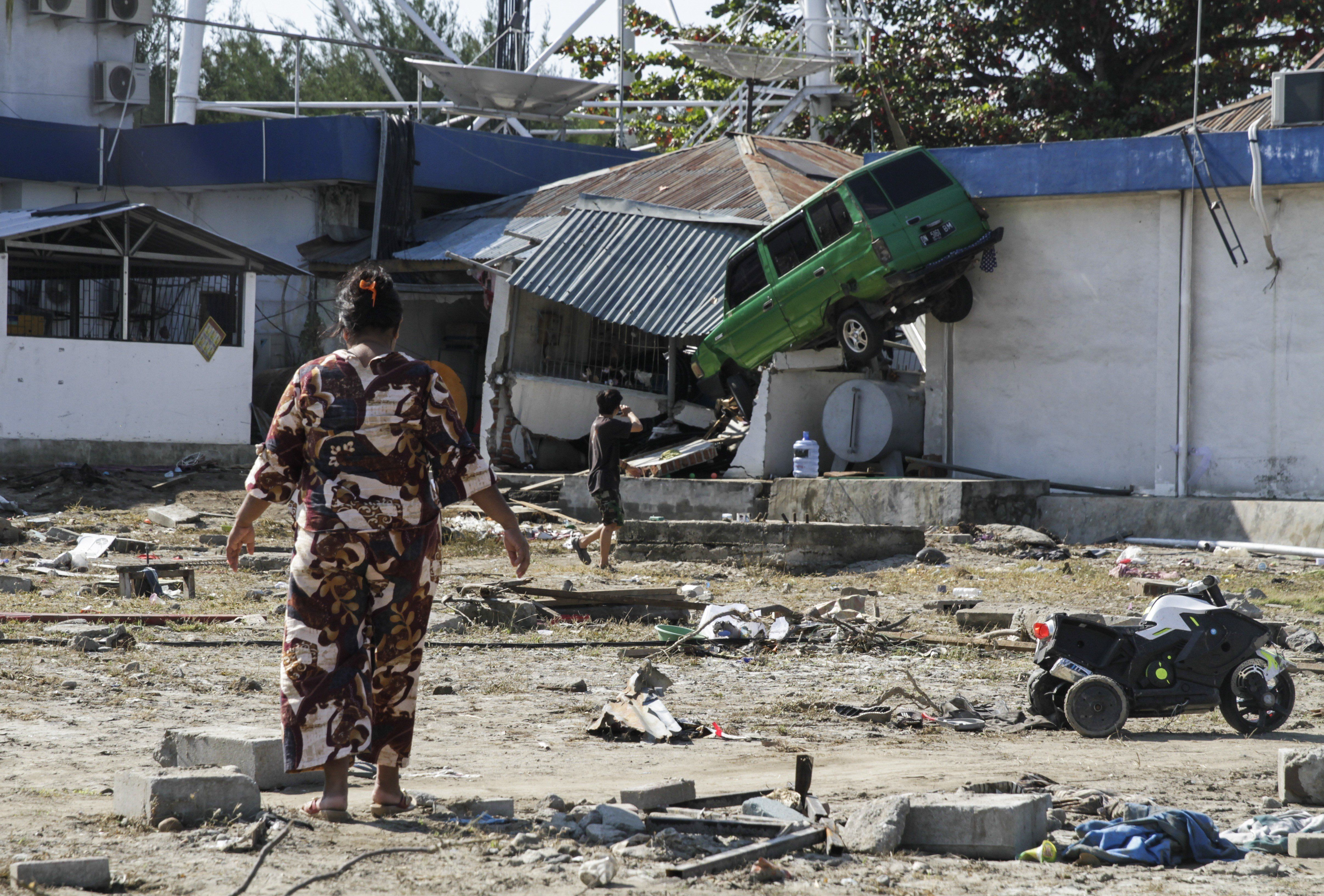 Houses and vehicles damaged by earthquake and tsunami are seen on Talise beach area, Palu, Central