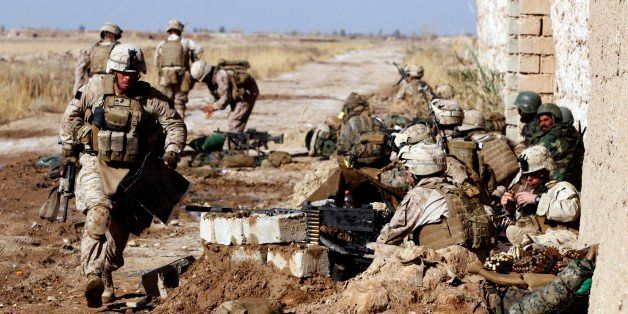 A Marine with Weapons Platoon, Charlie Company, 1st Battalion, 3rd Marine Regiment, sprints down the line of heavy machine gu