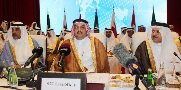 Kuwaiti Foreign Minister Sheikh Sabah al-Khaled al-Sabah (L), Qatari Foreign Minister Khalid bin Mohamed al-Attiyah (C) and G