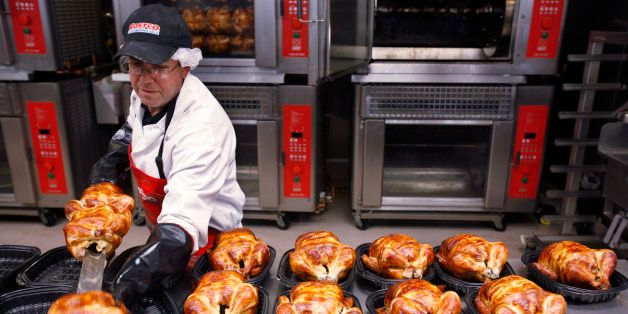 FILE - In this file photograph made March 3, 2010, a Costco employee cooks chicken at Costco in Mountain View, Calif. A priva
