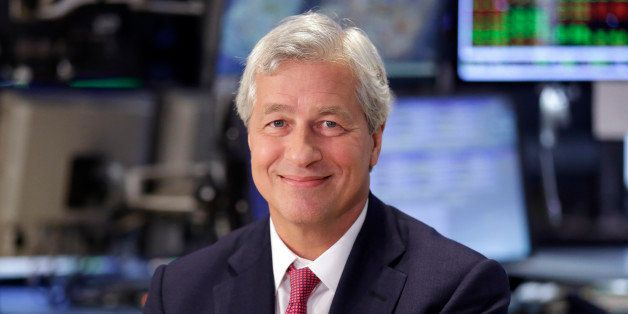 FILE - In this July 12, 2013 file photo, JP Morgan Chase Chairman and CEO Jamie Dimon is interviewed on the floor of the New