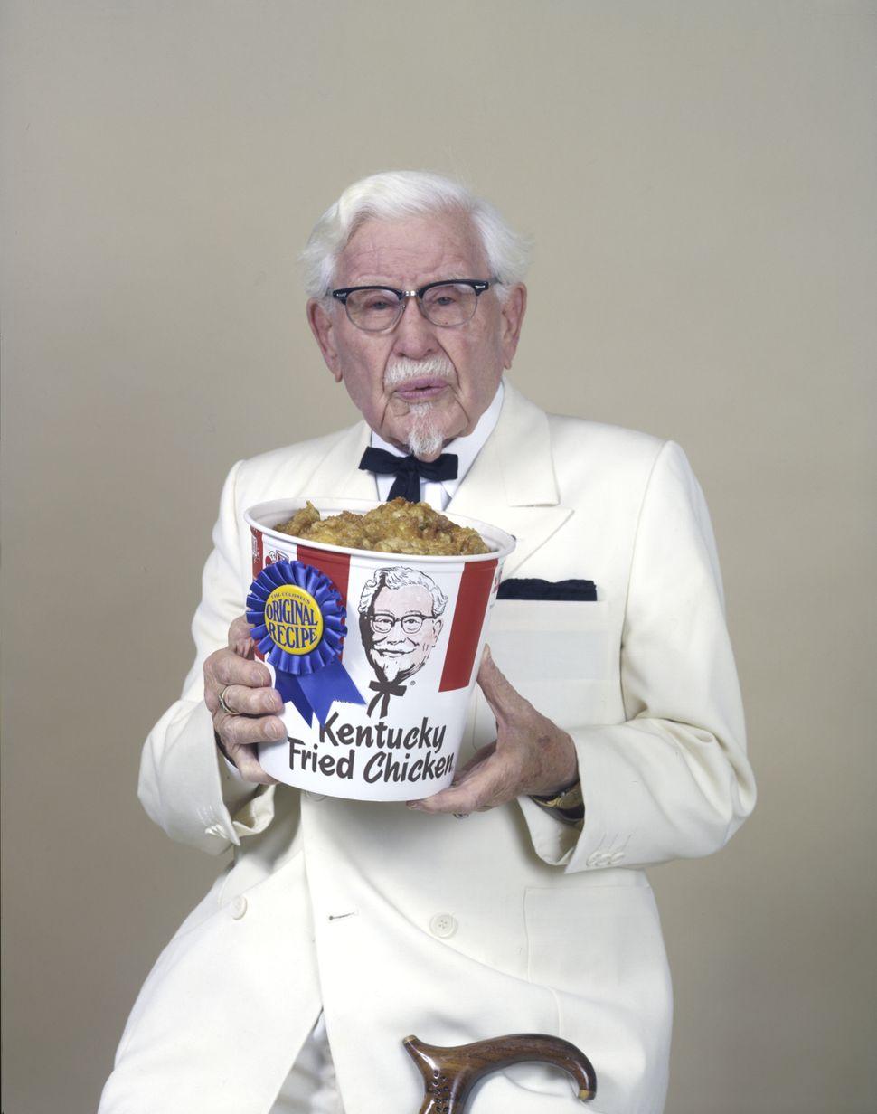 Colonel Sanders shows off a bucket of his award-winning Original Recipe Kentucky Fried Chicken (circa 1970).