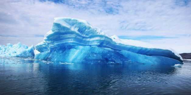 QAQORTOQ, GREENLAND - JULY 30:  Calved icebergs from the nearby Twin Glaciers are seen floating on the water on July 30, 2013
