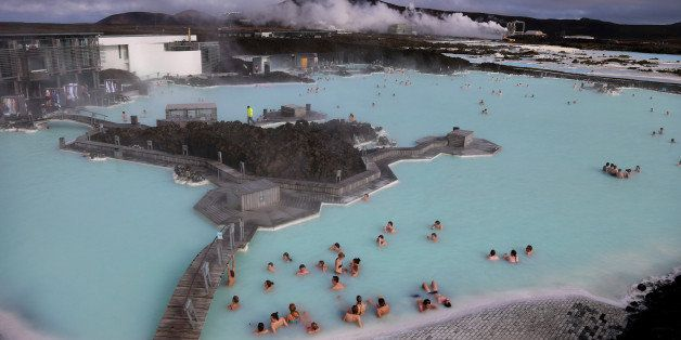 REYKJAVIK, ICELAND - APRIL 07:  Visitors sit in the geothermal waters at the Blue Lagoon close to the Icelandic capital of Re