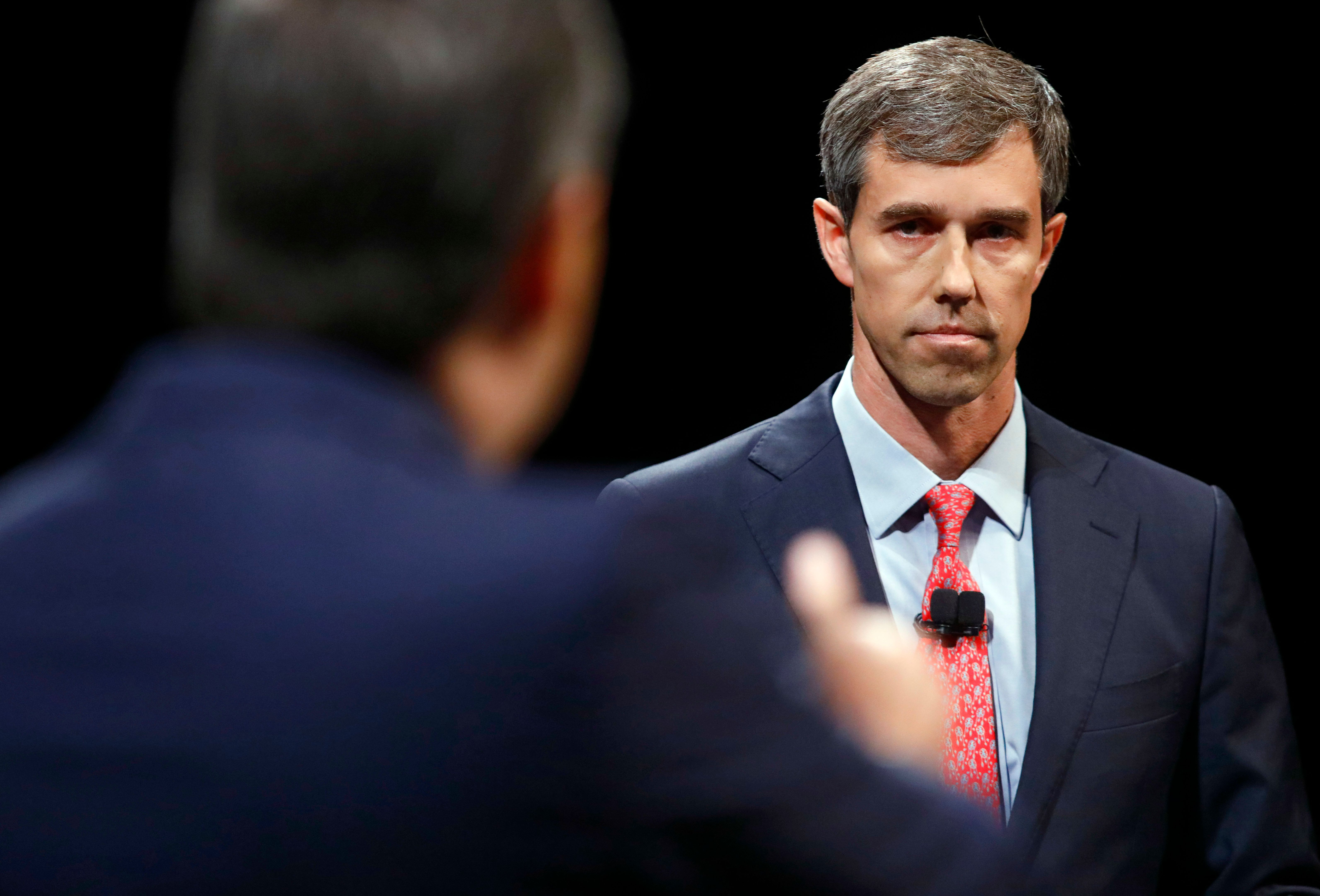 DALLAS, TX - SEPTEMBER 21: Rep. Beto O'Rourke (D-TX) looks and listens to Sen. Ted Cruz (R-TX) during a debate at McFarlin Auditorium at SMU on September 21, 2018 in Dallas, Texas. (Photo by Tom Fox-Pool/Getty Images)