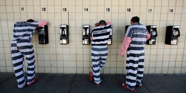 Inmates talk on pay phones in Maricopa County Sheriff Joe Arpaio's jail in Phoenix on Thursday, Jan. 31, 2008. The Tent City