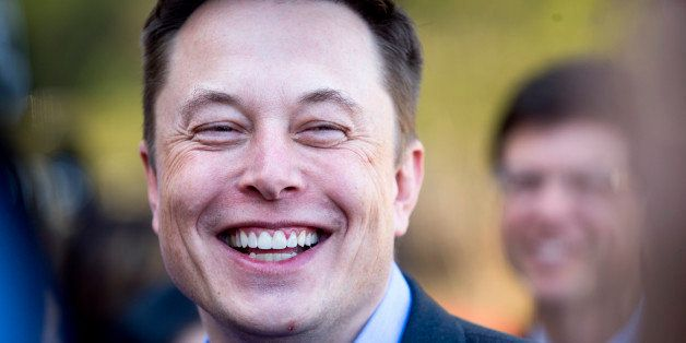 FILE - In this April 30, 2015, file photo, Tesla CEO Elon Musk speaks with members of the media at Tesla's headquarters in Pa