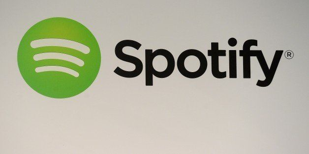 A Spotify logo is seen as founder and CEO Daniel Ek addresses a press conference in New York, December 11, 2013. The music st
