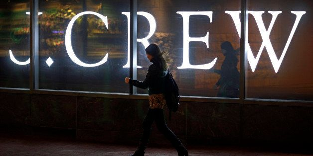 In this April 15, 2013 picture, a woman walks past a J. Crew retail store in Baltimore. Americans increased their spending in