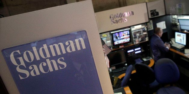 FILE - In this March 15, 2012 photo, a trader works in the Goldman Sachs booth on the floor of the New York Stock Exchange. Goldman Sachs more than doubled its first-quarter profits and announced plans to raise its dividend Tuesday, March 17, 2012. The strong results masked other problems, including a 16 percent decline in revenue. To make up for that, and to propel earnings higher, Goldman turned to cost-cutting. (AP Photo/Richard Drew)