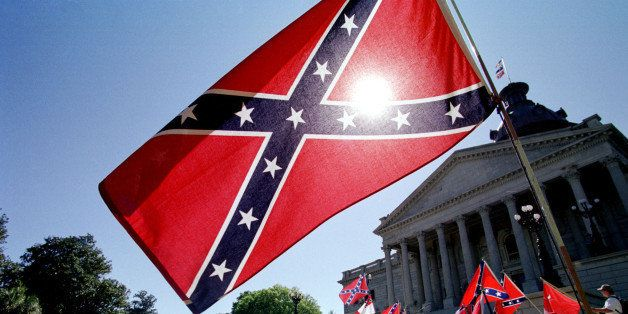 COLUMBIA, SC - APRIL 6:  Confederate flag supporters demonstrate on the north steps of the capitol building 06 April, 2000 in