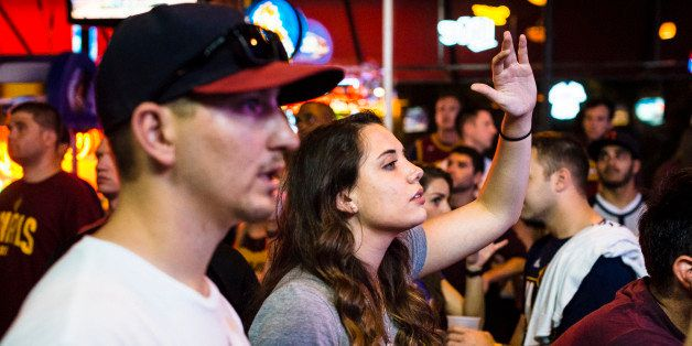CLEVELAND, OH- JUNE 16:  Cleveland Cavaliers fans react while watching Game 6 of the NBA Finals at Paninis Bar and Grill on J