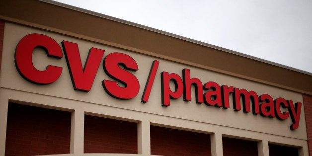 This March 17, 2014 photo shows a CVS/Pharmacy in Dormont, Pa. CVS Health reports quarterly financial results on Tuesday, Nov