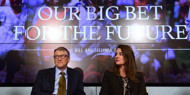Bill (L) and Melinda Gates, founders of the Bill and Melinda Gates Foundation, take part in a discussion organised by British