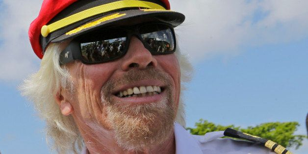 Richard Branson, founder of the Virgin Group, center, arrives, Tuesday, June 23, 2015, at Perez Art Museum in Miami. Branson