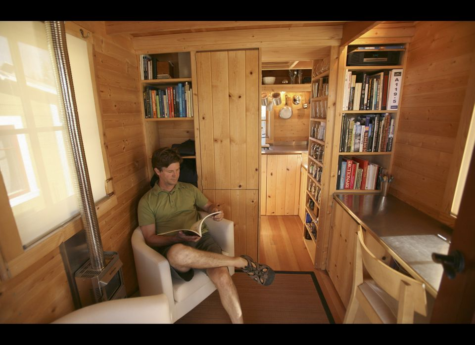 In this photo taken Oct. 14, 2010, Jay Schafer, owner of Tumbleweed Tiny Houses is seen inside one of the homes he built for