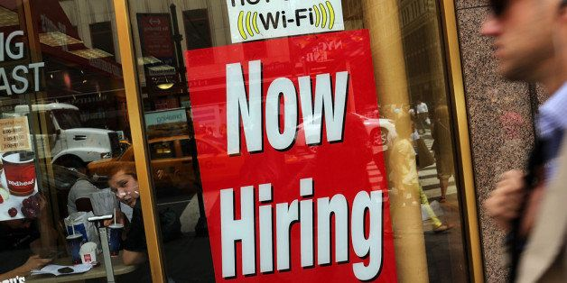 NEW YORK, NY - AUGUST 07:  A 'now hiring' sign is viewed in the window of a fast food restaurant on August 7, 2012 in New Yor
