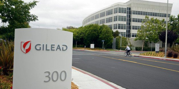 In this photo taken Thursday, July 9, 2015, a man cycles near the headquarters of Gilead Sciences in Foster City, Calif. (AP