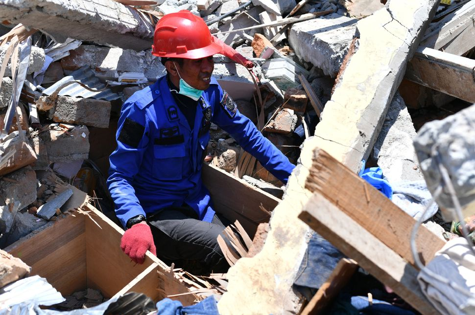 Search and rescue teams continue to climb through the rubble, in hopes of finding survivors.
