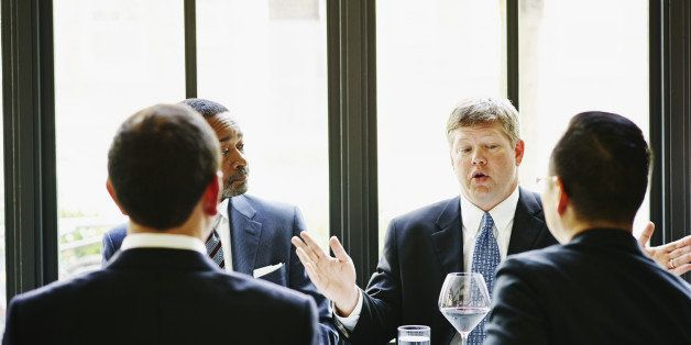 Business executive leading discussion during business meeting in restaurant