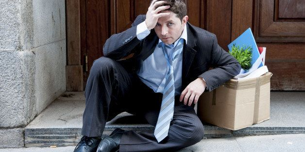 frustrated and sad business man in stress sitting on edgy street corner depressed and desperate,  fired from work in crisis a
