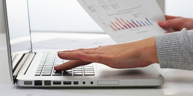 Female using laptop with financial data