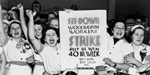 Female employees of Woolworth's holding a sign indicating they are striking for a 40 hour work week, New York, New York, 1937