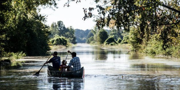 COLUMBIA, SC - OCTOBER 6:  People canoe down South Beltline Road October 6, 2015 in Columbia, South Carolina. The state of So
