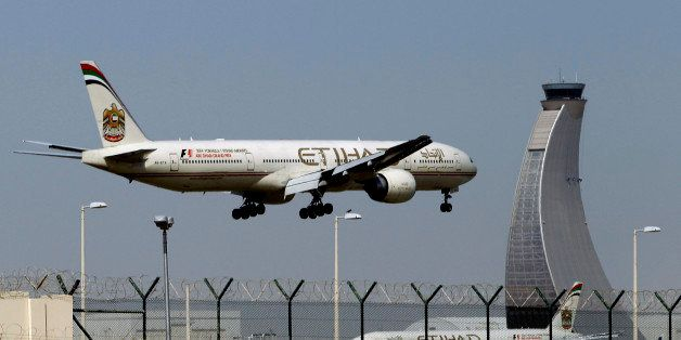 FILE - In this May 4, 2014 file photo, an Etihad Airways plane prepares to land at the Abu Dhabi airport in the United Arab E
