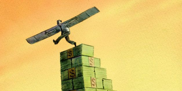 Businessman with wings stepping off stack of money