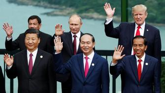Leaders pose during the family photo session at the APEC Summit in Danang, Vietnam November 11, 2017. (Front L-R) China's President Xi Jinping, Vietnam's President Tran Dai Quang, Indonesia's President Joko Widodo, (back L-R) Philippines' President Rodrigo Duterte, Russia's President Vladimir Putin, U.S. President Donald Trump. REUTERS/Jorge Silva
