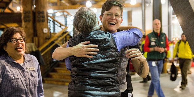 SEATTLE, WA - OCTOBER 27:  Employees of Specialty Outdoor Retailer REI react to news of Black Friday closure at 143 stores na