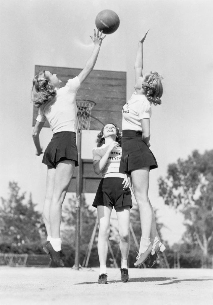 group of young woman playing...