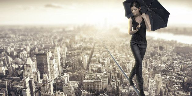 woman walking on a rope over manhattan