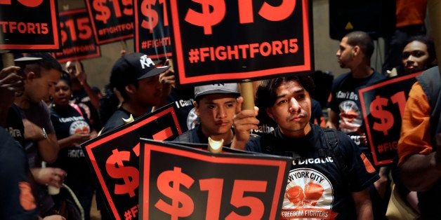 Demonstrators rally for a $15 minimum wage before a meeting of the wage board in New York, Monday, June 15, 2015. The board,