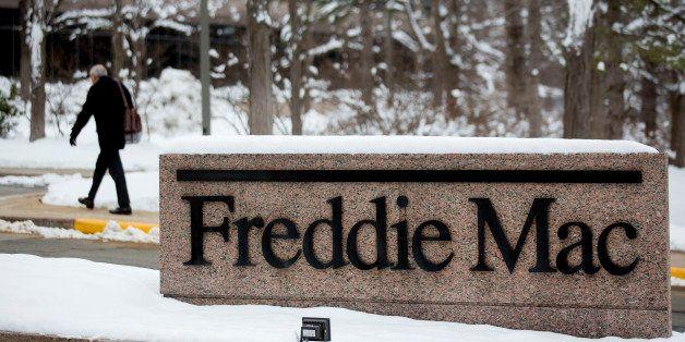 A man walks into the Freddie Mac headquarters in McLean, Virginia, U.S., on Tuesday, March 18, 2014. Freddie Mac and Fannie M