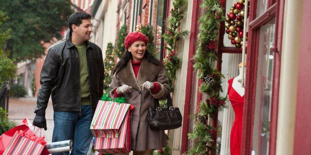 Hispanic couple shopping at Christmas