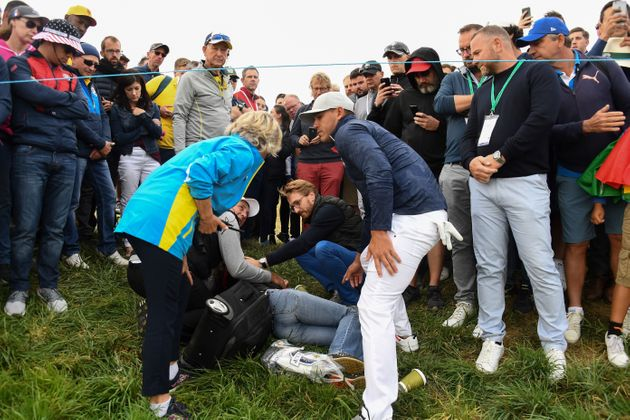 US golfer Brooks Koepka (right) rushed to the injured