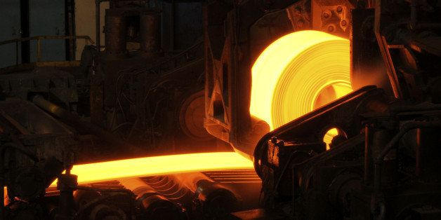Hot orange steel rolling process in a steel manufacturing industry. Hot rolling is a metalworking process used mainly to prod