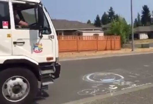 Street sweeper Wendel Lamb saw an anxious little girl watching him as he approached her chalk art in Courtenay, B.C. He lifte